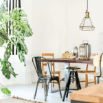73044246 – bright dining room with table, chairs, bookshelf and green plant